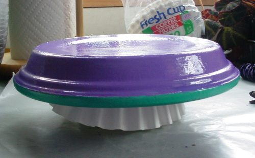 Coffee filters between the saucer and the butter tub add a cusion that protects the paint from getting marred.