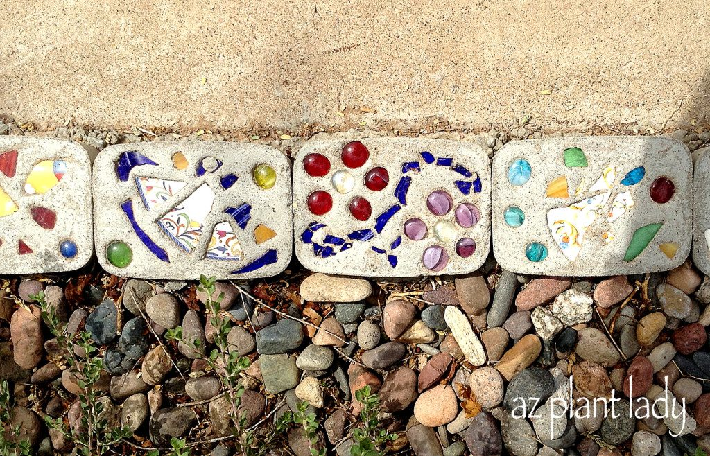 Diy stepping stones and border birds and blooms for Decorative stone garden border