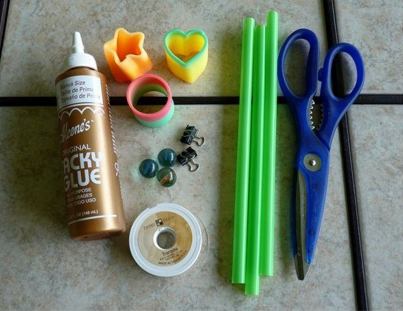 Slinky Flower supplies include magic springs, marbles, straws, and craft glue.