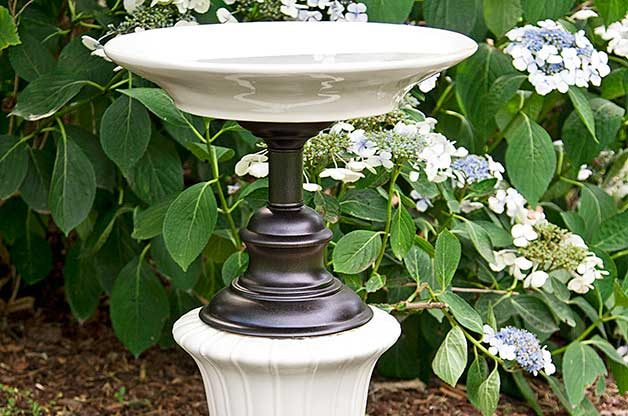 Recycled Garden Ideas: Use old lamp bases as pedestals for birdbaths or planters.