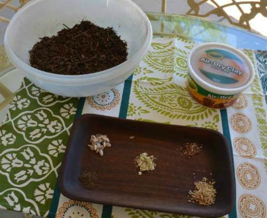 Potting soil (or compost), terra-cotta air-dry clay and seeds