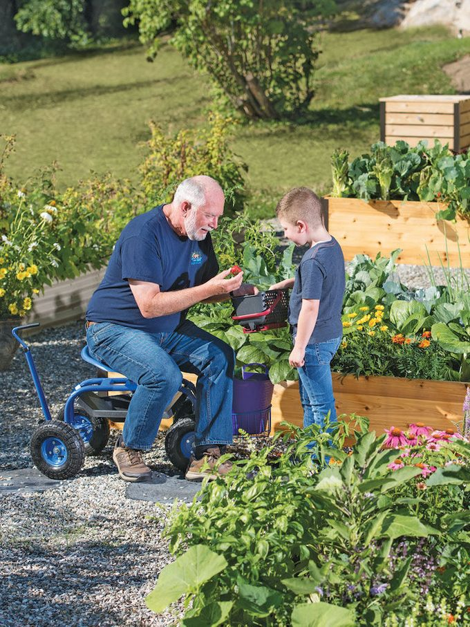 Man Uses Tractor Scoot in the garden