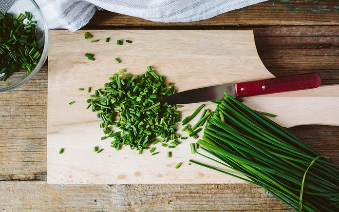 Chives on a wooden board