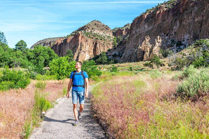 Man hiking at Bandelier National Monument
