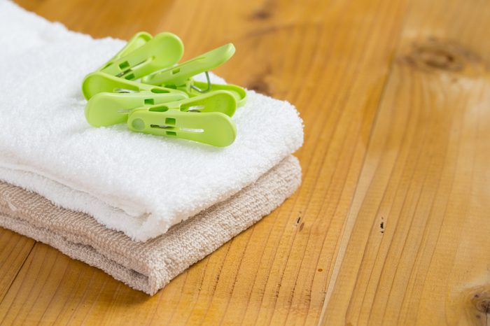 housekeeper folding towels & clothes