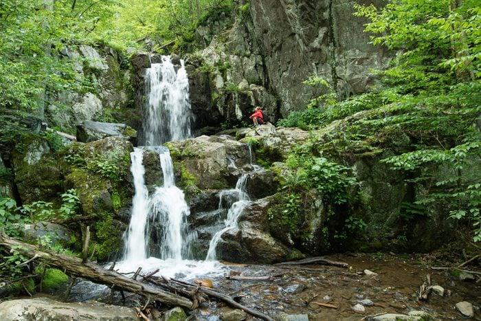 Man exploring Doyles river falls, Shenandoah National Park, Virginia, USA