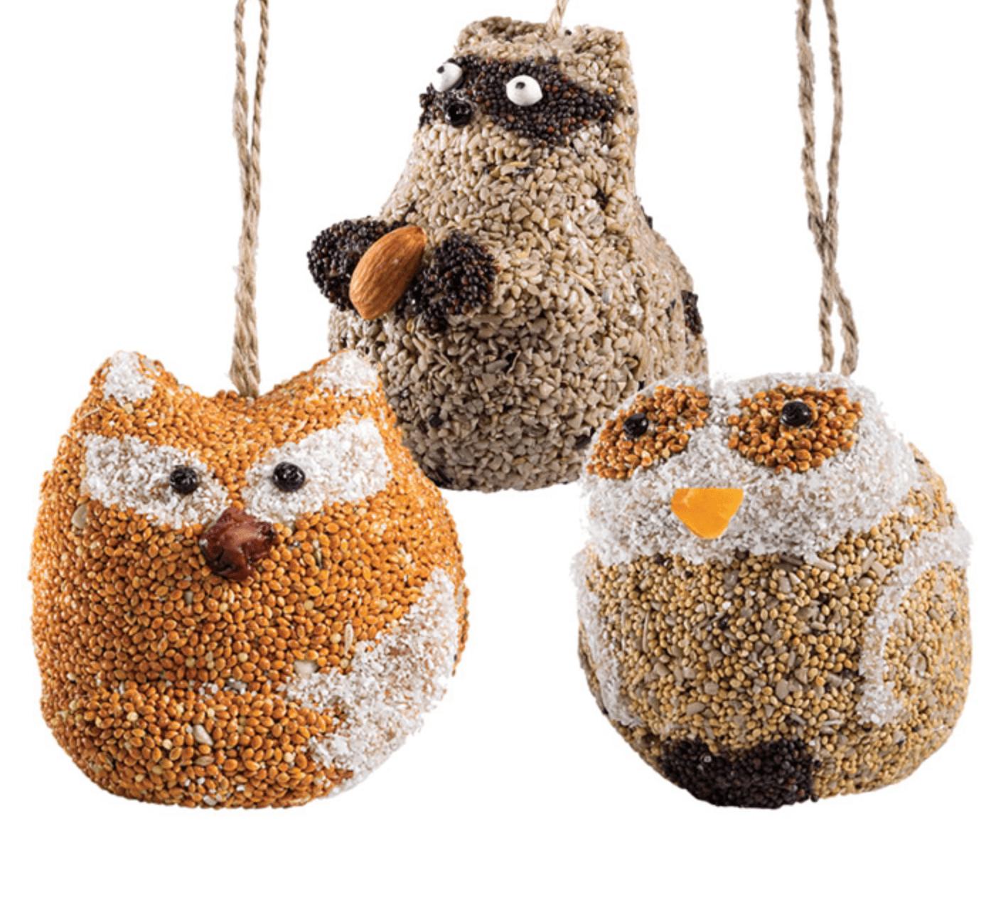 A fox, owl and raccoon seed ornament.