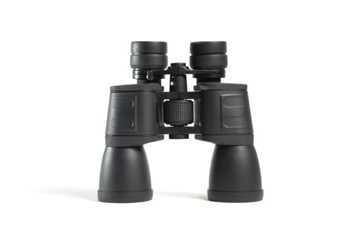Close-Up Of Binoculars On Black Background