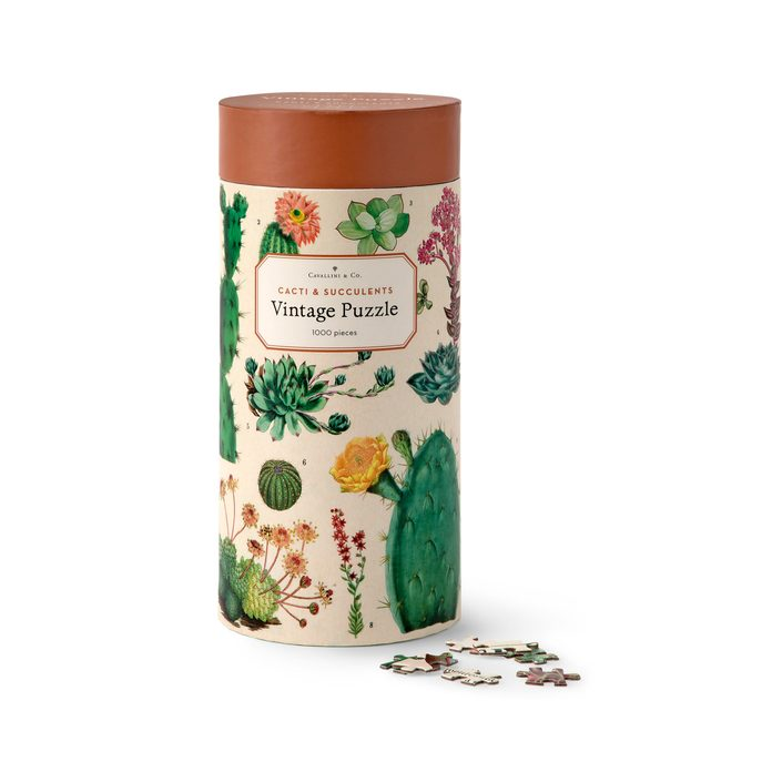 A decorative container and puzzle pieces.