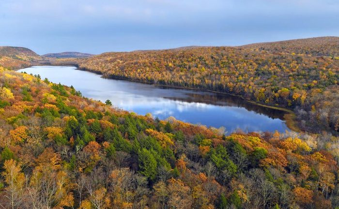 Fall foliage surrounding Lake of the Clouds in Michigan's Porcupine Mountains
