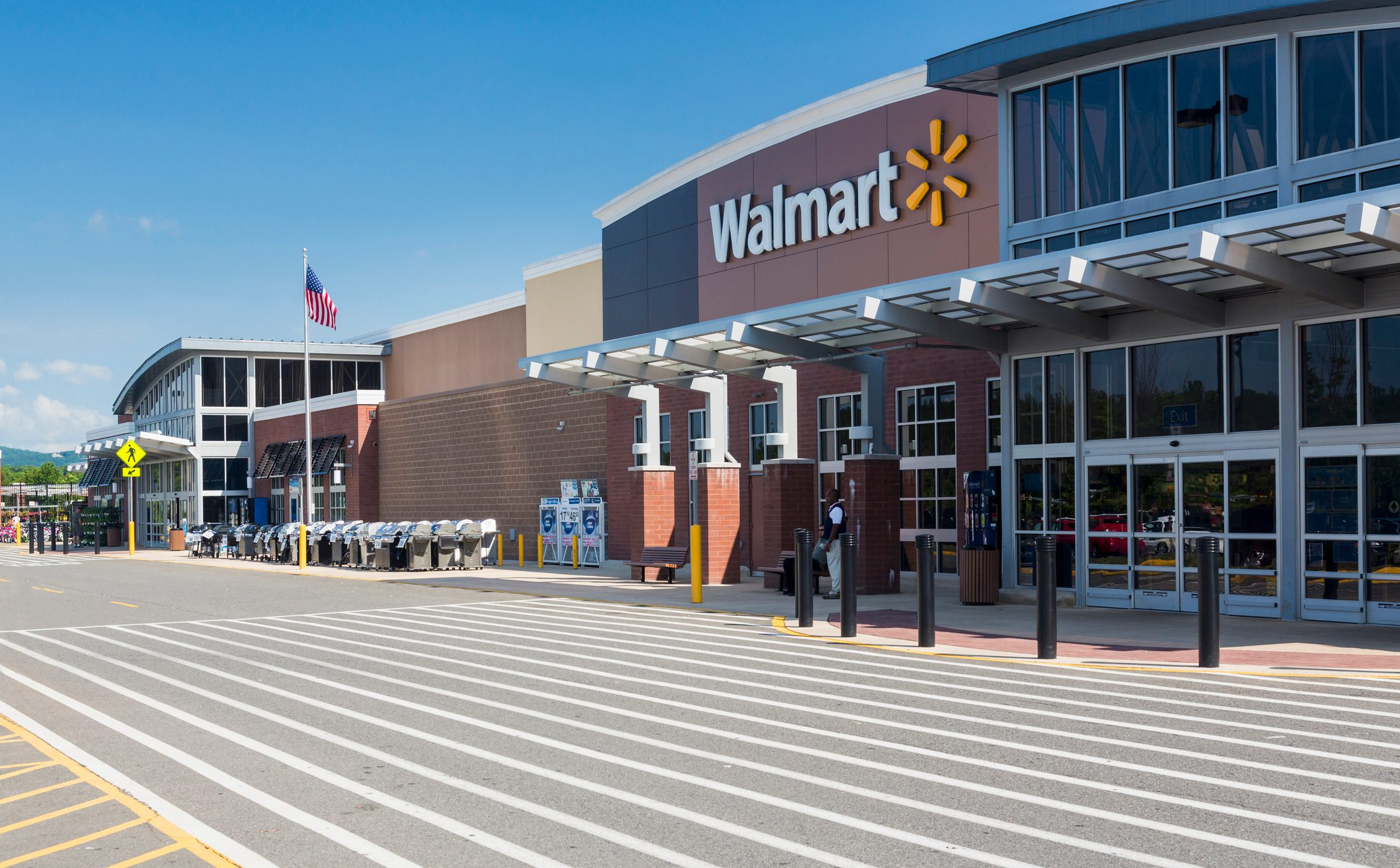 Entrance to large Walmart food supermarket or superstore in Haymarket, Virginia, USA