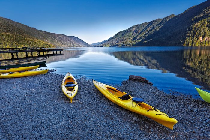 Olympic National Park in Washington State of United States. Water sport of canoes and kayaks at Lake Crescent.