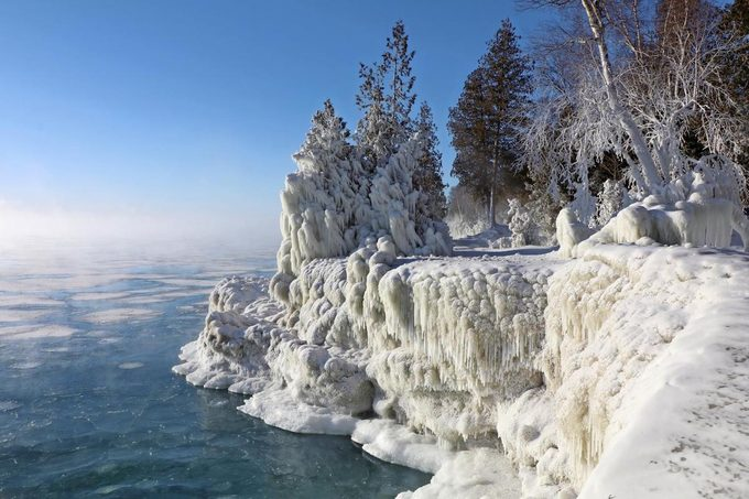 An icy view of Cave Point shoreline in winter.