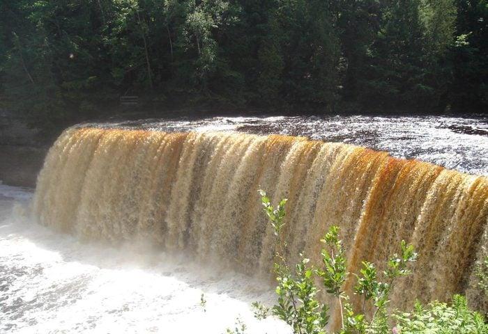 An image of Tahquamenon Falls in the Upper Peninsula of Michigan.