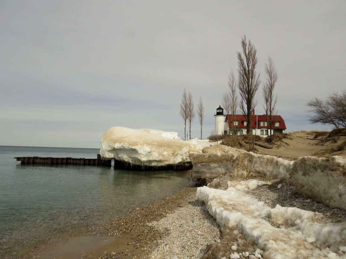 Winter scene of Fort Betsie lighthouse on the shores of Lake Michigan.
