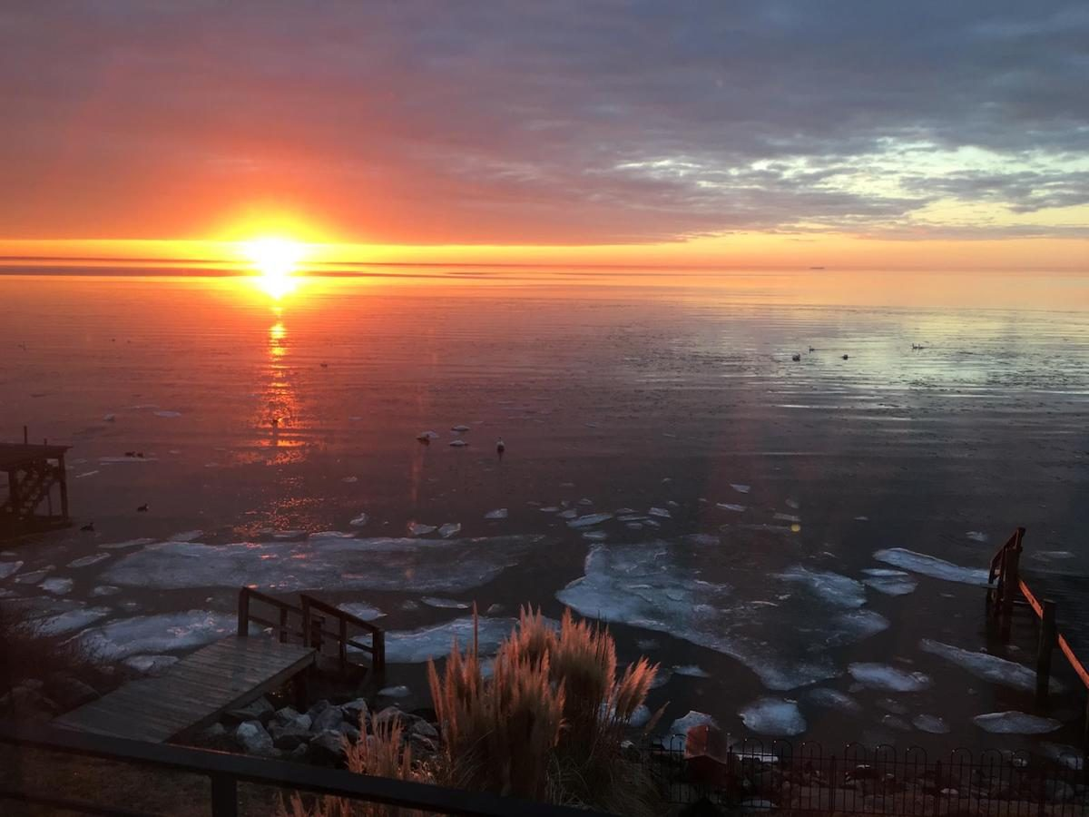 Sunset on an icy winter shoreline in Chesapeake Bay.
