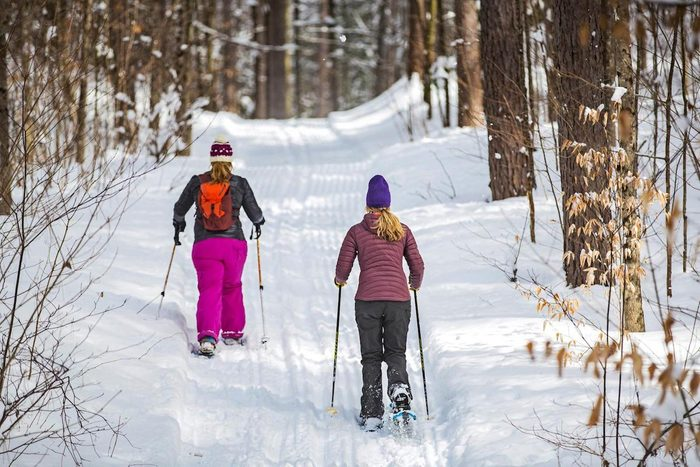 Two women snowshoeing near Woodstock, Vermont.
