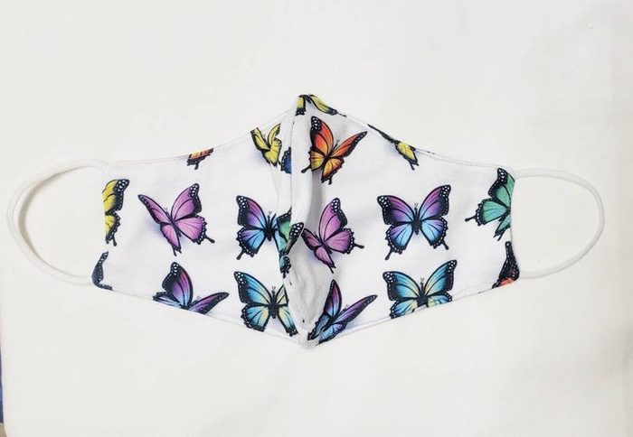 white butterfly face mask