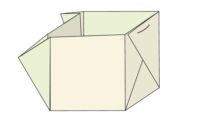 A partially folded and stapled newspaper pot.