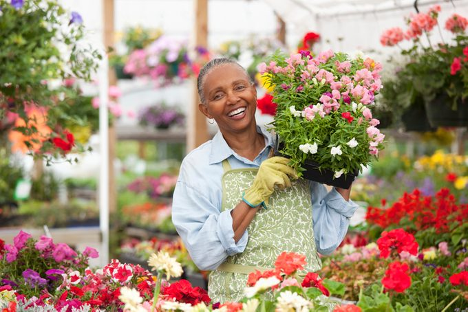 Black woman carrying flowers